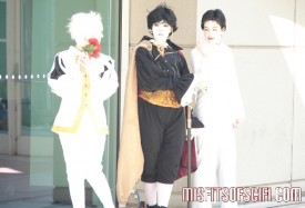Costumed trio pose outside 2