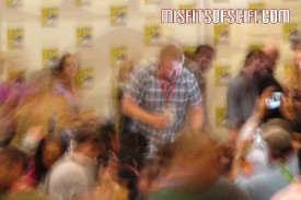 Walking Dead Panel - creator Robert Kirkman signs autographs while zombies shuffle in background