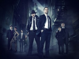 GOTHAM (L-R) Series stars Robin Lord Taylor as Oswald Cobblepot/The Penguin, Jada Pinkett Smith as Fish Mooney and Cory Michael Smith as Edward Nygma/future Riddler; guest star Clare Foley as Ivy Pepper/future Poison Ivy; and series stars Donal Logue as Detective Harvey Bullock, Ben McKenzie as Detective James Gordon, Camren Bicondova (above, on fire escape) as Selina Kyle/future Catwoman, David Mazouz as Bruce Wayne and Sean Pertwee as Alfred Pennyworth in Warner Bros. Television's Gotham, which is based on the characters from DC Comics. The series will air Mondays at 8/7c on FOX this fall. (Photo Credit: © Warner Bros. Entertainment Inc. All Rights Reserved.)